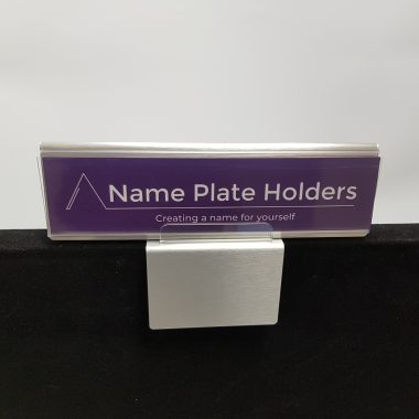 Raised name tag holder
